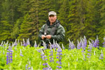Eric in a meadow of lupines